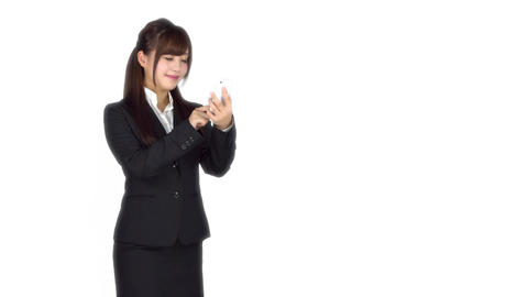 Young Japanese business woman texting on iphone 이미지