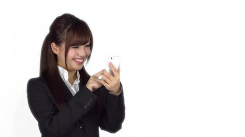 Young Japanese business woman texting on iphone Footage
