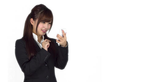 Disappointed young Japanese business woman texting iphone Footage