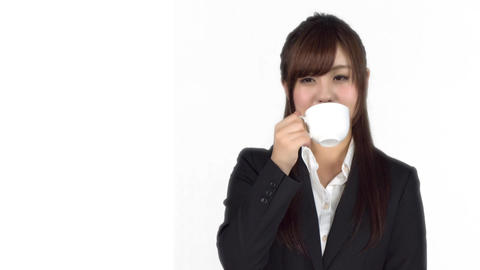 Young Japanese business woman drinking from coffee cup Footage