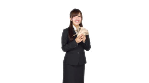 Young Japanese business woman counting money Live Action