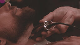 Barber hand cutting beard with clipper barbershop HD slow motion close up video Footage