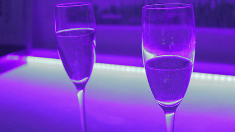 Close-up of two glasses of sparkling champagne, romantic date Footage
