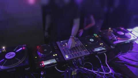 Top view of DJ mixing, playing music on professional sound deck Footage