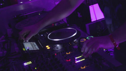 DJ using professional sound equipment, software, playing music Footage