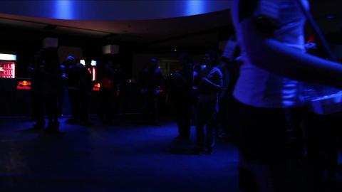 Hot women promoting tobacco sales at nightclub, people dancing Footage