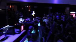 DJ set at nightclub, public enjoying music, dancing, clubbing Live Action