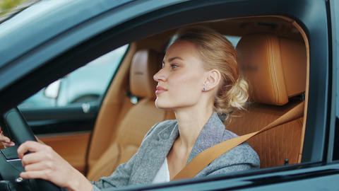 Closeup business woman dancing at automobile. Businesswoman sitting in new car Live Action