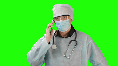 Young doctor in medical mask and protective medical clothing talking on the Live Action