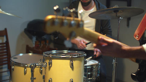 Slow motion Drummer and his band play in the garage Live Action