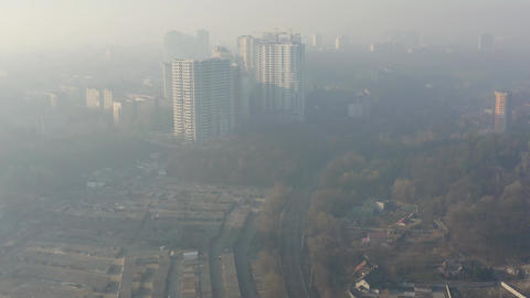 Aerial view of smog or fog hanging over the city. Air environmental pollution Live Action