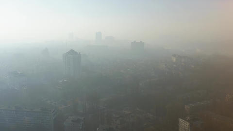 Aerial view of a dense smog or fog hanging over the city. Air environmental Live Action