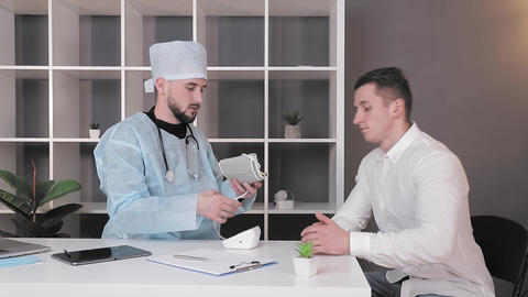 patient comes to the doctor's office. The doctor accepts the patient for an Live Action