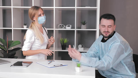 The patient and the doctor dance and laugh with happiness. The patient is Live Action