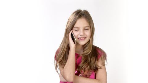 Emotional conversation on the phone of a little girl. A little girl is on the Live Action