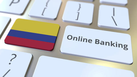 Online Banking text and flag of Colombia on the keyboard. Internet finance Live Action