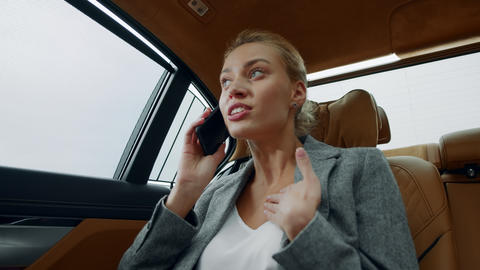 Stressed business woman talking phone at car. Woman arguing on phone at car Live Action