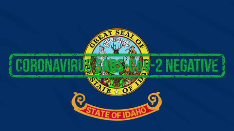 Idaho US state swaying flag with green stamp of freedom from coronavirus, loop Animation