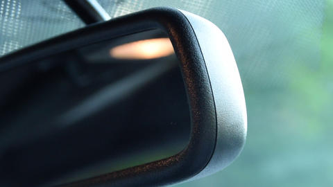 Close Up shot of rear view mirror with sunflair in Ford Mustang Muscle Car Live Action