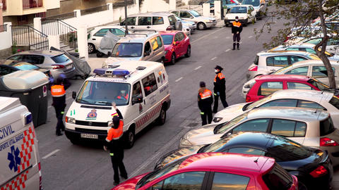 Granada Spain 9 April, 2020: People applaud civil defense workers, doctors and police looking out of Live Action