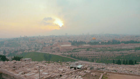 Panoramic view of Jerusalem old city and the Temple Mount during a dramatic colorful sunset Live Action