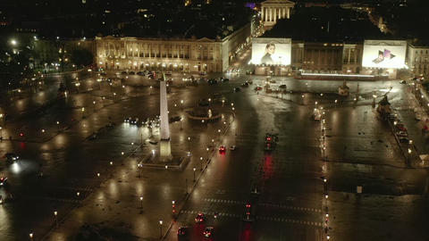 AERIAL: Flight over Place de la Concorde in Paris, France at Night with Wet Live Action