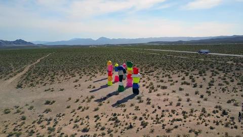 Aerial push, Seven Magic Mountains in desert near Las Vegas Live Action