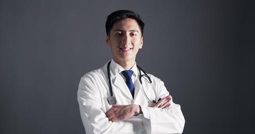 Portrait of Smiling Confident asian Doctor Live Action