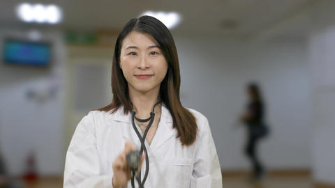 C Asian female doctor stethoscope doors open ward background act Live影片