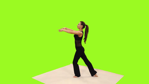 Slender young woman in black bodysuit doing yoga on transparent background Footage
