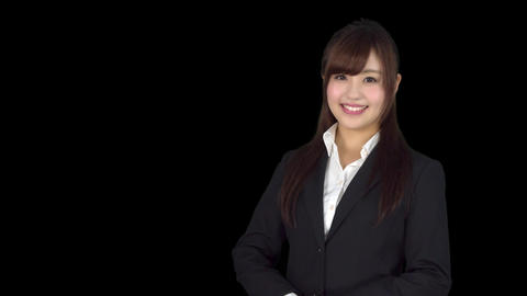 Young Japanese business woman welcomes Live Action