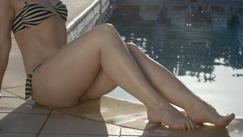 Hot female body near pool. Woman tanning, relaxing on vacation Footage