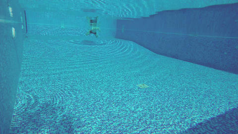 Underwater shot, man swimming in the pool. Active rest, sports Footage