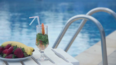 Fresh summer cocktail, fruit near swimming pool, all inclusive Footage