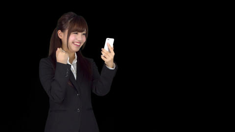 Surprised young Japanese business woman texting on iphone Footage