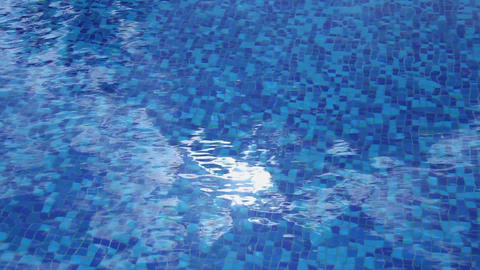 Sun reflection sparkle, blue water surface, hotel swimming pool Footage