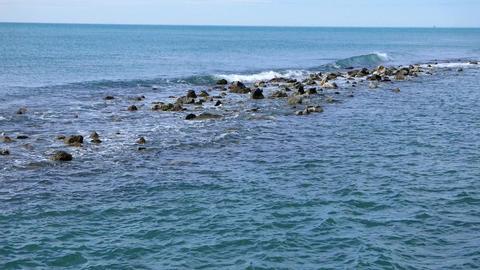 The waves rolled on the rocks. Tyrrhenian Sea Footage