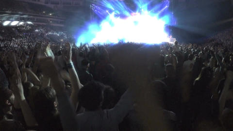 Many excited people enjoying concert, applauding waving hands, rockstar on stage Footage