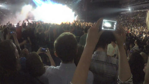 Guys addicted to gadgets filming concert on smartphone, taking picture on camera Footage