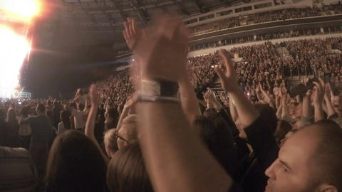 Crowd applauding in euphoria, clapping in tune with popular song during concert Footage