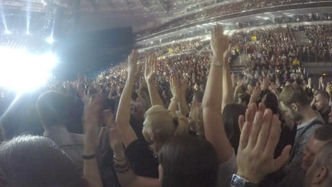 Thousands of young guys applauding to favorite band, singer, musician after show Footage