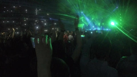 Amazing laser show at concert of worldwide famous popstar. People filming videos Footage