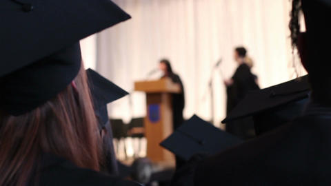 Excited young woman in academic cap applauding graduates. Diploma award ceremony Footage