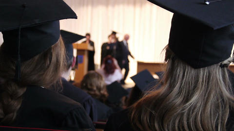 Student receiving higher education certificate from dean, graduation ceremony Footage