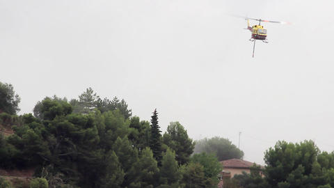 Firefighting Helicopter Makes A Water Drop To Protect A Home Footage
