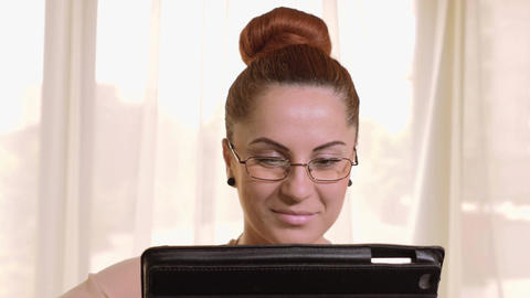Young beautiful business woman working on tablet pc and smiling Footage