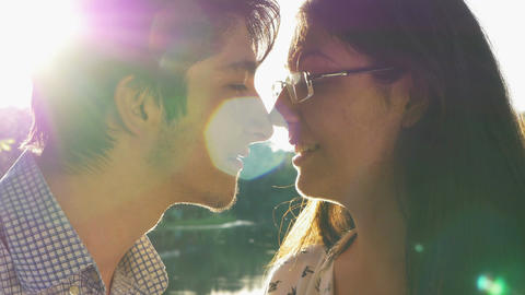 Close-up of loving couple kissing at sunset Footage