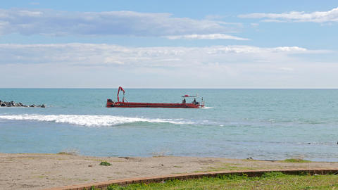 Red barge in the sea. Ostia, Italy Footage
