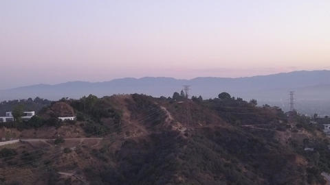 AERIAL: Over Hollywood Hills at Sunrise with view on…, Live Action