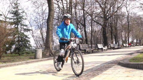 The boy rides a bike during the day. Sports lifestyle. Slow motion. Kyiv Live Action